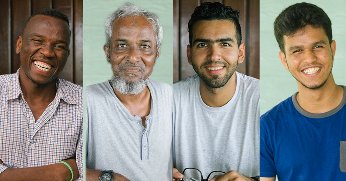 Photos of four men, who are detained on Manus Island. They are all smiling. One is older, with grey hair, while the others are young.