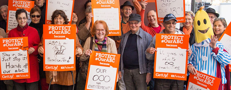 GetUp members holding placards with their messages of why they want to protect the ABC.
